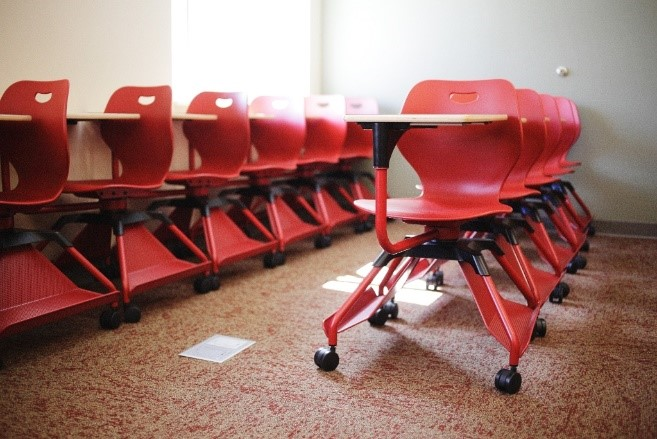 Desks arranged in rows in a classroom