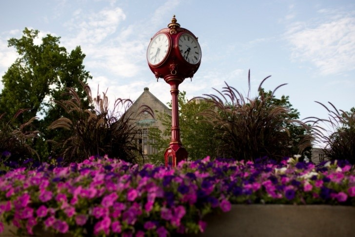 An iconic IU clock in the middle of campus